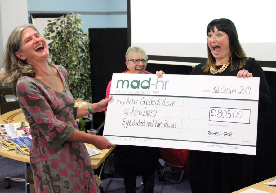 MAD-HR present ActivGardens with cheque donation