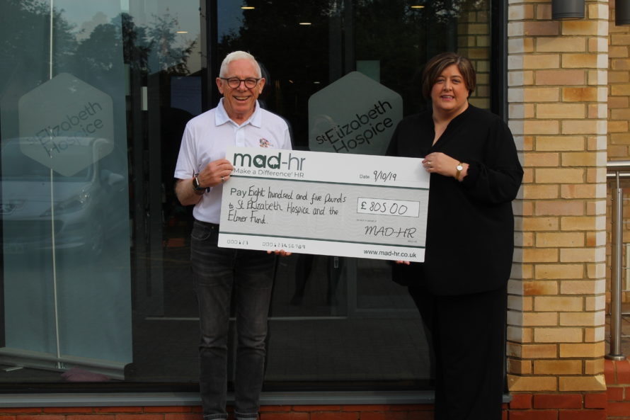 Carole Burman of MAD-HR presents the Elmer Parade fund with their cheque